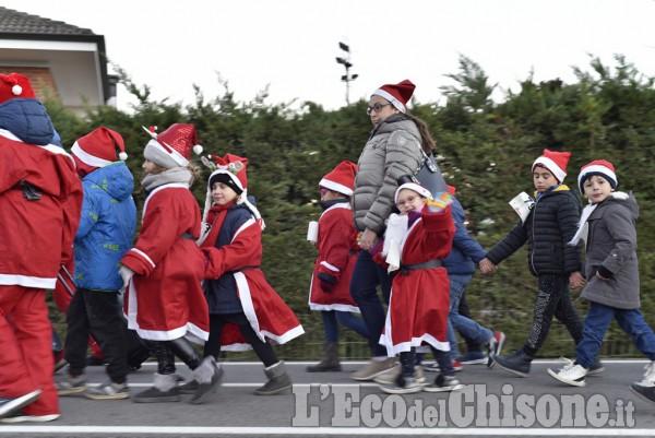 Vigone tra luci e bambini Babbo Natale
