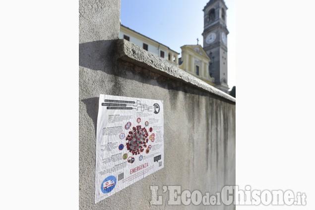 Effetto Coronavirus: dialoghi a distanza sui muri o sulle serrande abbassate