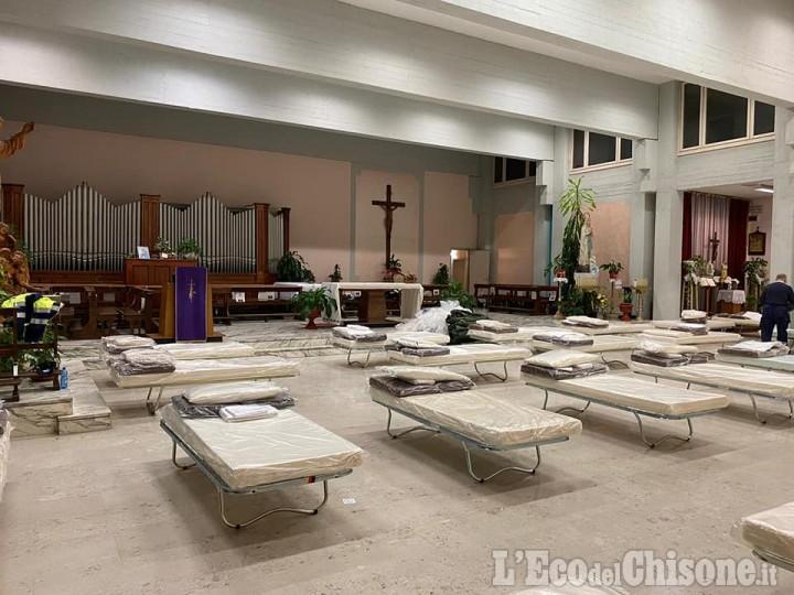 Orbassano: al san Luigi sono stati allestiti dei posti letto anche nella chiesa interna e nella sala convegni